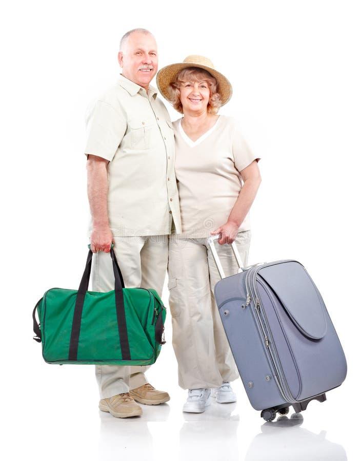 Elderly couple. Tourist elderly seniors couple . Isolated over white background royalty free stock image