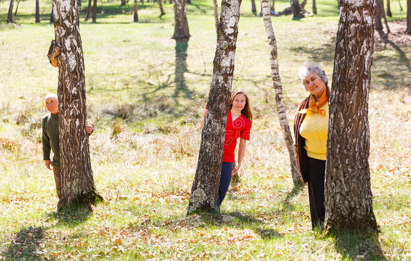 Elderly couple and young caregiver. Having fun together royalty free stock photo
