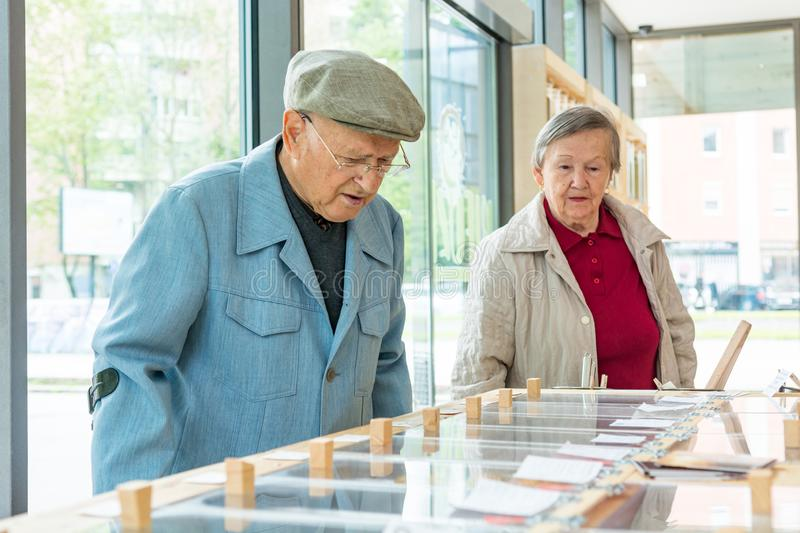 Elderly couple in a zero waste store bulk shopping. Healthy life style at old age royalty free stock images