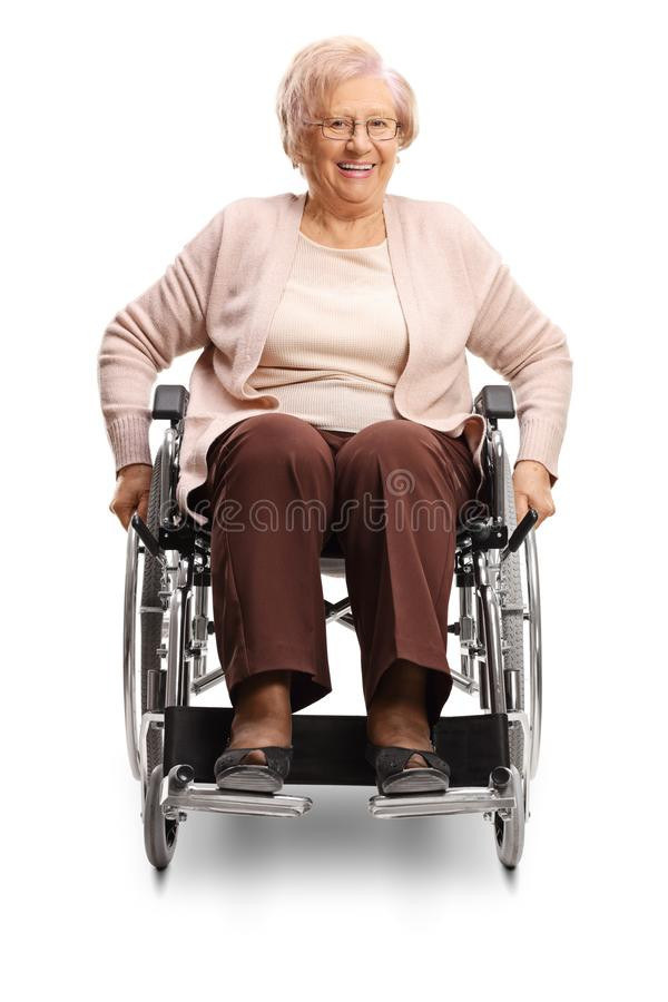 Elderly disabled female in a wheelchair. Isolated on white background stock photography