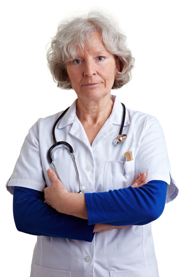 Elderly doctor with arms crossed stock images