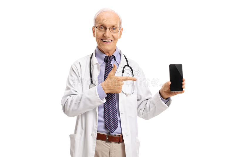 Elderly doctor showing a phone and pointing. Isolated on white background stock photo