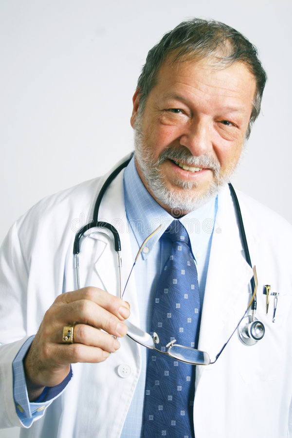 Download Elderly doctor smiling stock photo. Image of healthy, elder - 4130568