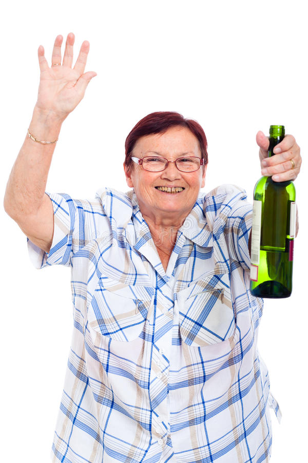 Elderly drunk woman with bottle of alcohol