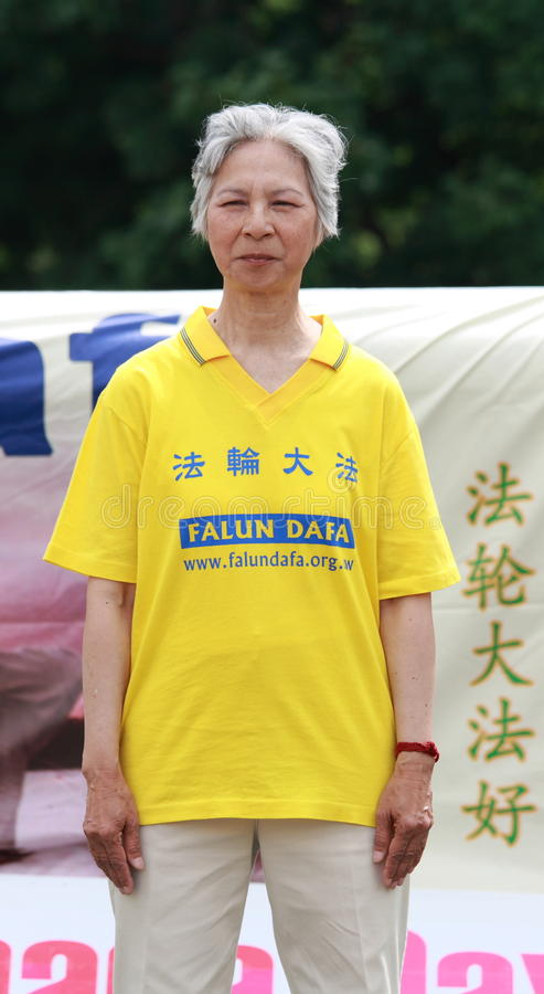 Download Elderly Falun Dafa Woman editorial stock image. Image of grey - 25596684