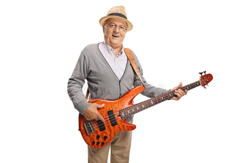 Elderly gentleman playing a bass guitar royalty free stock images