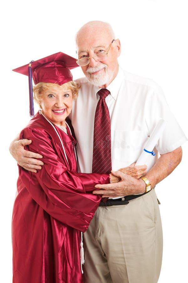 Elderly Graduate With Proud Husband Stock Photography
