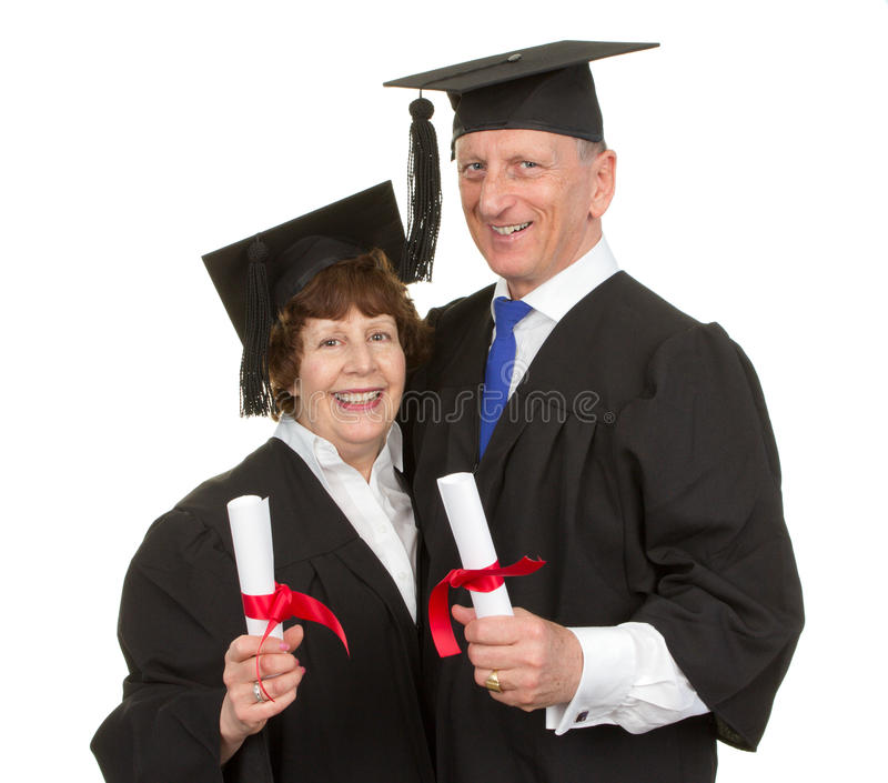 Elderly graduates. Two elderly graduates with their scrolls, isolated on white stock photos