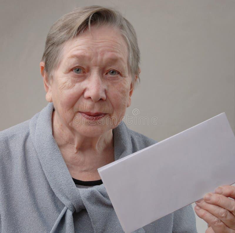 Elderly happy woman. Portrait of the elderly happy woman royalty free stock image