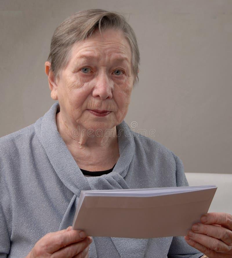 Elderly happy woman. Portrait of the elderly happy woman stock photography