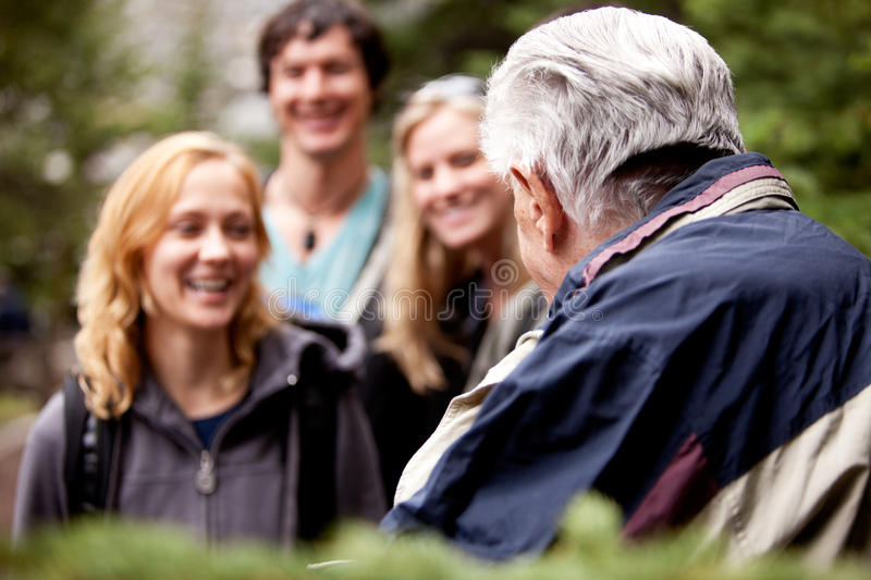 Elderly Hiking Guide royalty free stock images