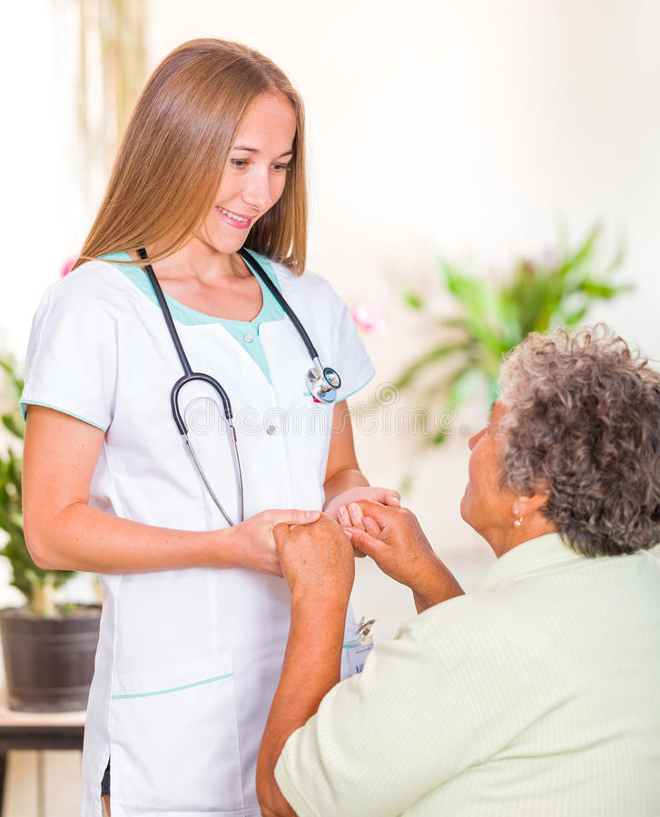Elderly home care. Photo of elderly women with the young doctor stock images