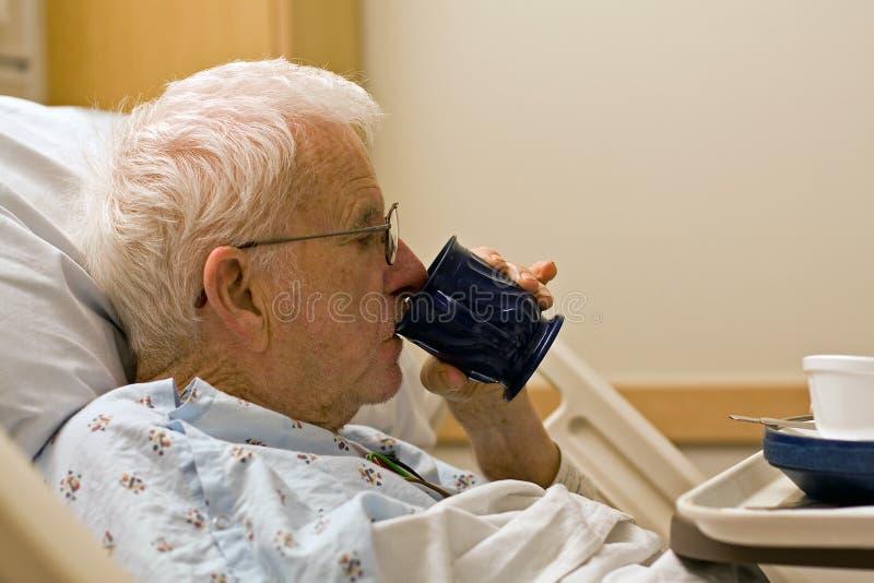 Elderly Hospital Patient Drinking Coffee Stock Photo