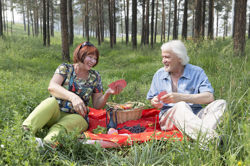 Elderly husband and wife had a picnic in the woods royalty free stock photography