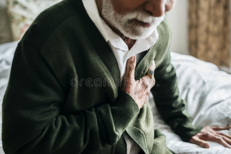 An elderly Indian man with heart problems royalty free stock images