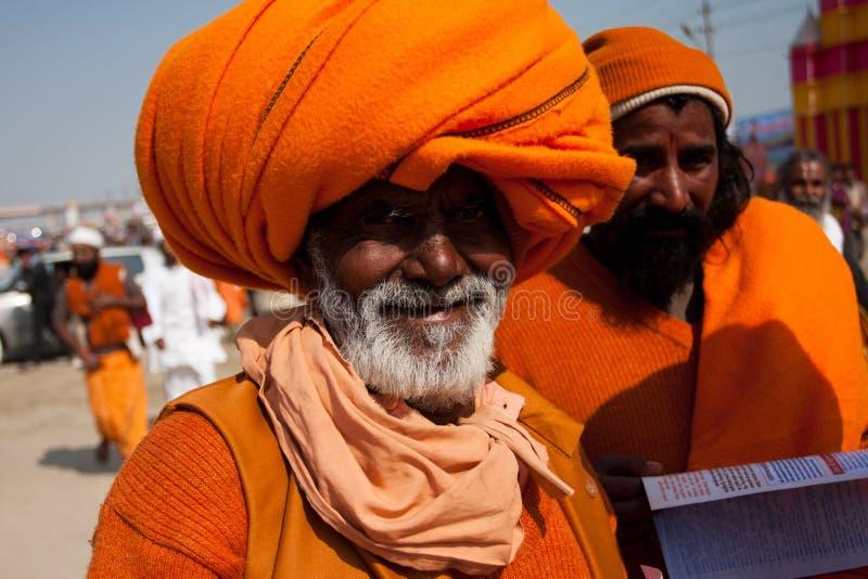 Elderly indian pilgrim in orange turban stock photos