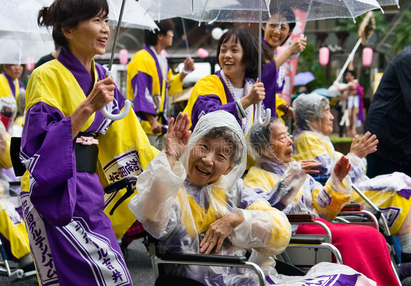 Elderly Japanese Festival Dancers in wheelchairs. Kagoshima City, Japan, November 3rd, 2008. Elderly Japanese Festival Dancers in wheelchairs at the Ohara stock photography