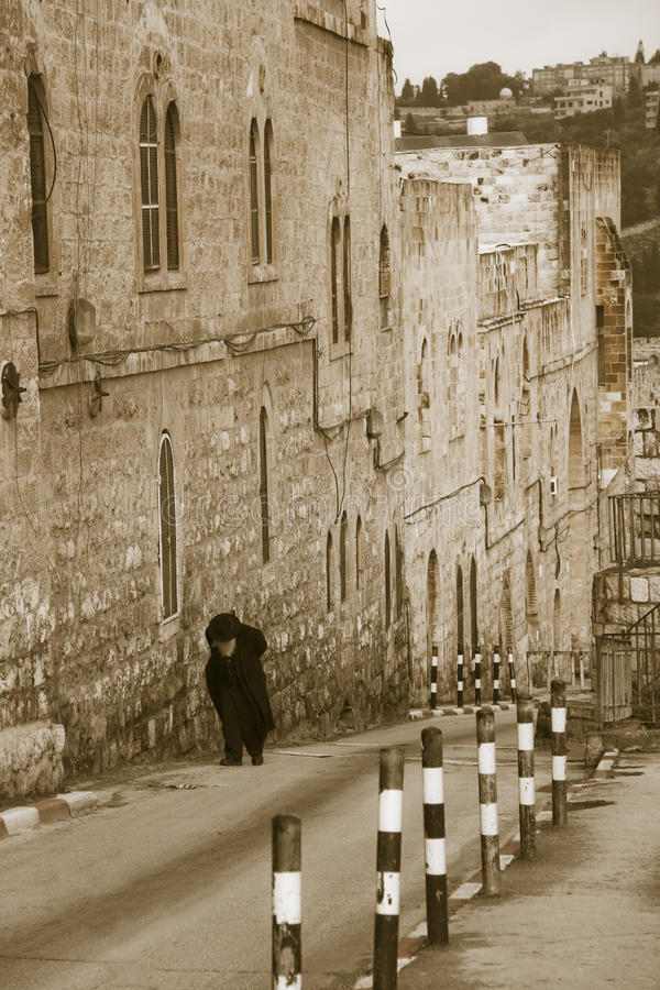 Elderly jewish man climbing to the Old City stock photography