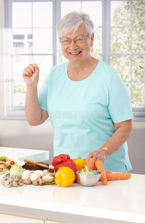 Elderly lady eating healthy stock photo