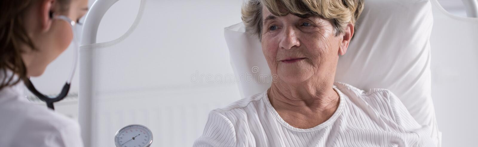 Elderly lady examined by doctor stock images