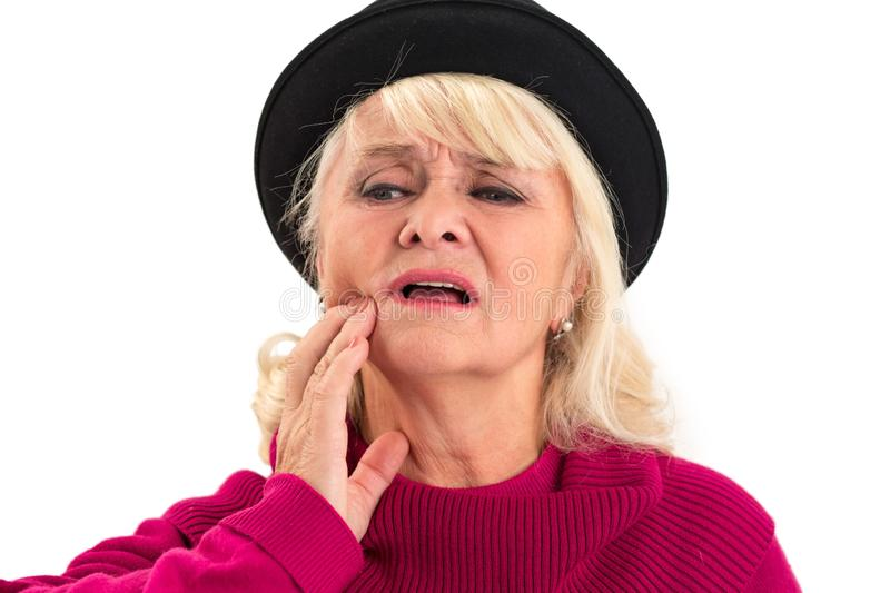 Elderly lady having toothache isolated. stock image