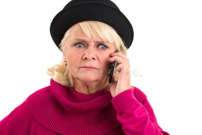 Elderly lady is holding cellphone. stock photography
