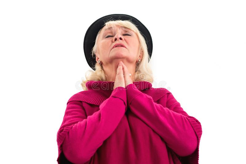 Elderly lady praying isolated. stock photo