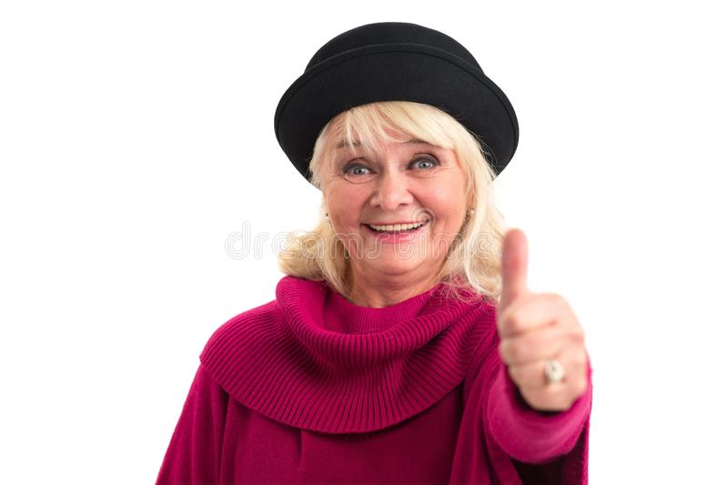 Elderly lady showing thumbs up. royalty free stock image