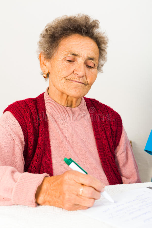 Elderly Lady Signing Contract stock photo