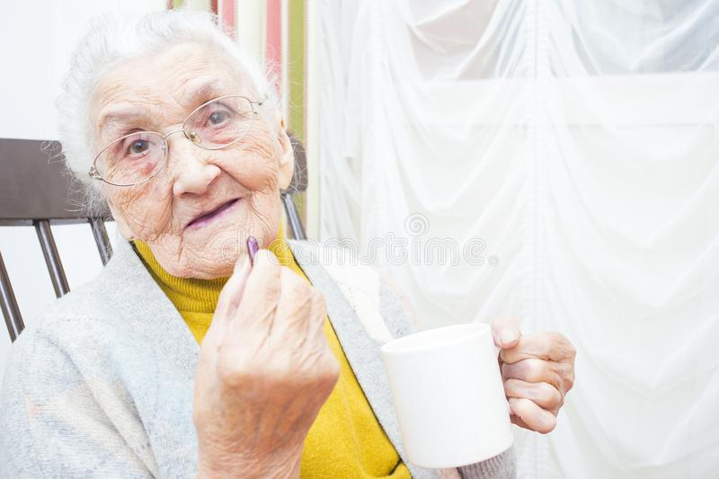 Elderly lady taking medication royalty free stock photo