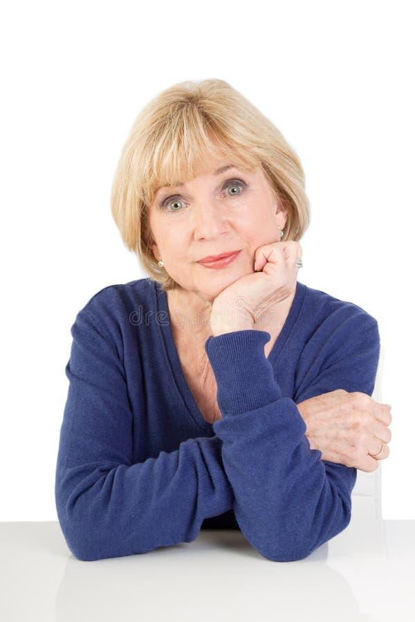 Elderly lady thinking isolated on white background stock photography