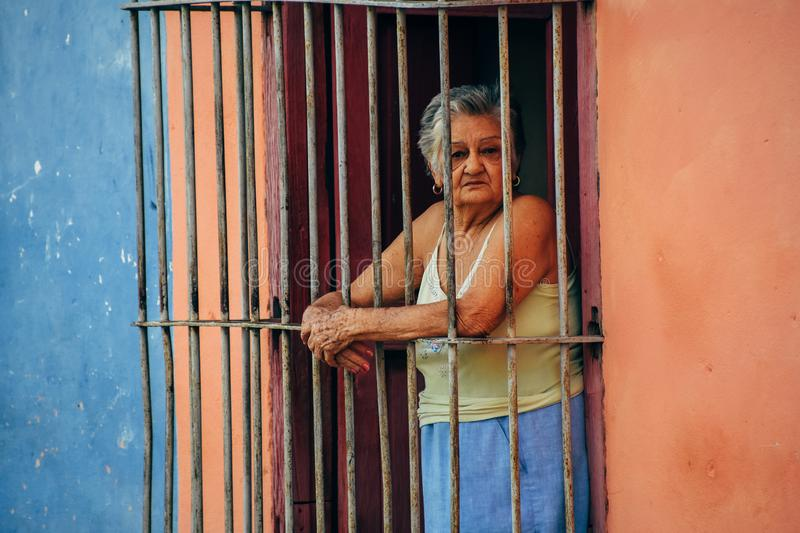 A elderly local posses for the camera in Trinidad, Cuba. stock photography