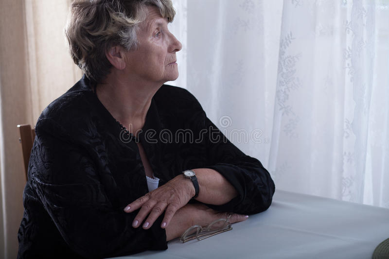 Elderly lonely widow missing stock image