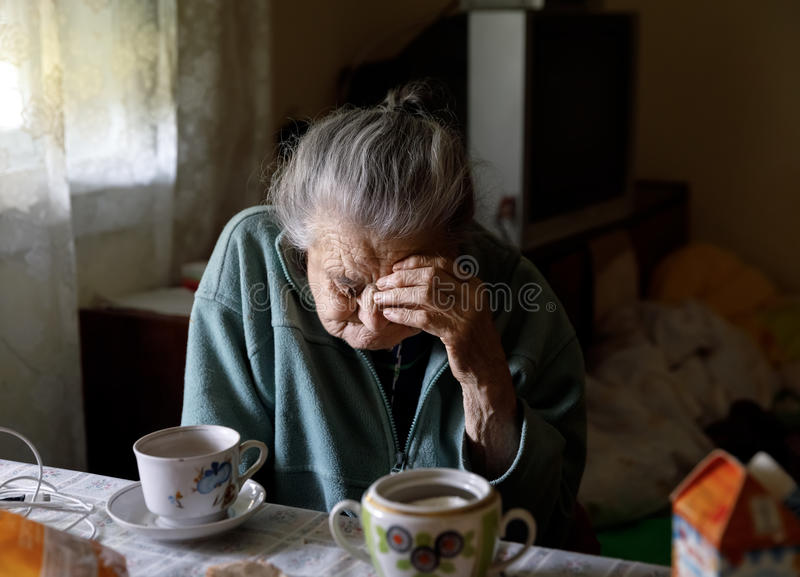 Elderly lonely woman stock images