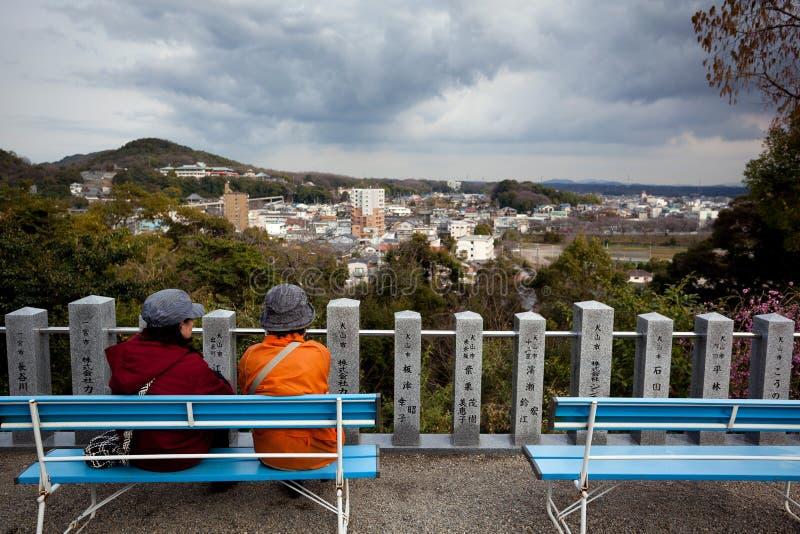 Elderly look at scenery stock photos