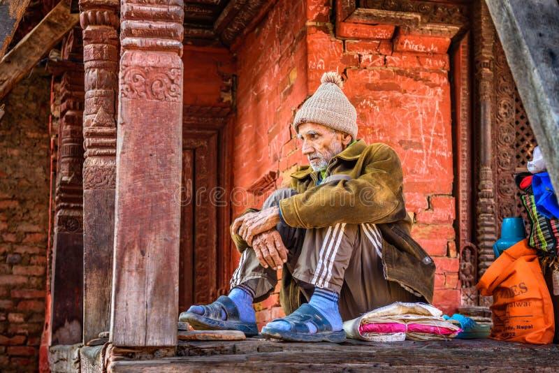 Elderly man begging at Pashupatinath Temple complex in Kathmandu. KATHMANDU, NEPAL - OCTOBER 20, 2015 : Elderly man begging at Pashupatinath Temple complex in royalty free stock photo