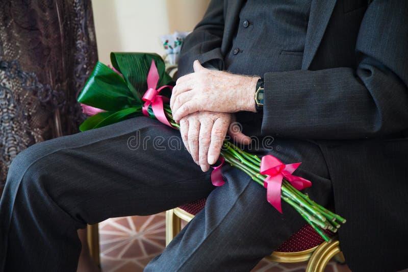 Elderly man with bouquet