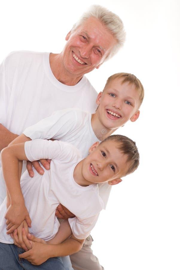 Elderly man and boys stock photo