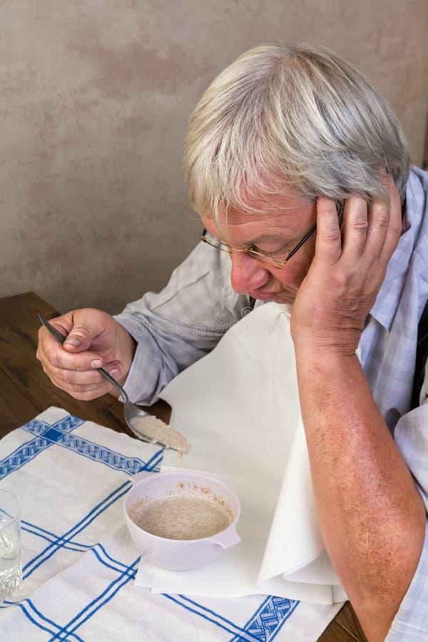 Elderly man at breakfast stock photography