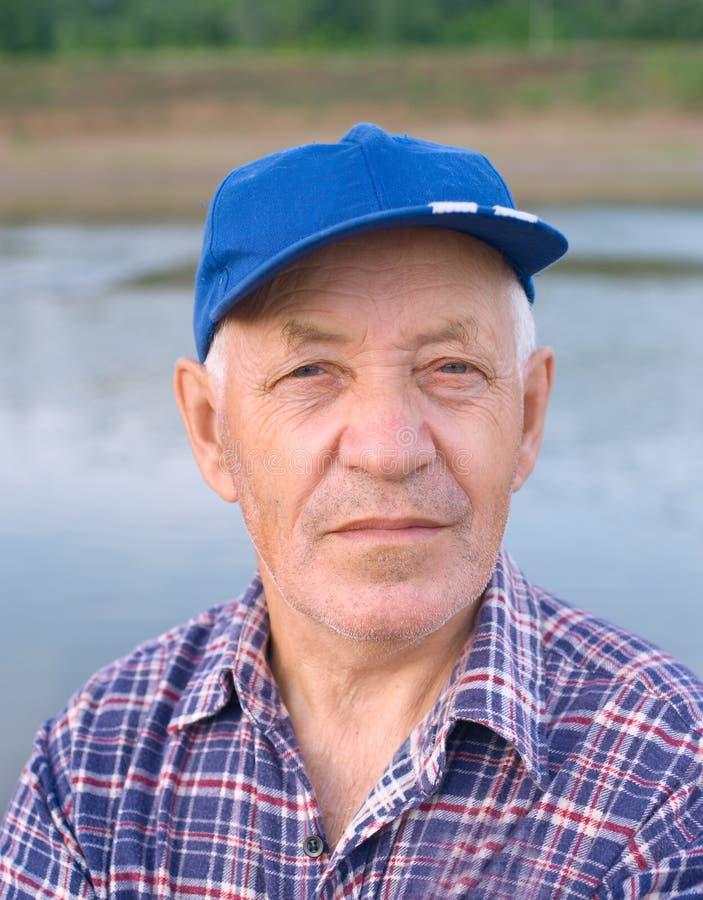 Download Elderly man in cap stock photo. Image of shirt, grief - 10075644