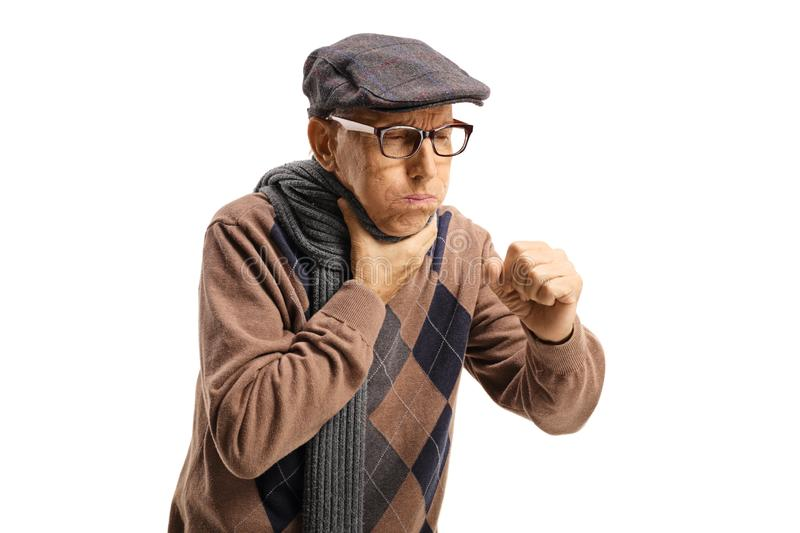 Elderly man coughing and holding his throat royalty free stock image