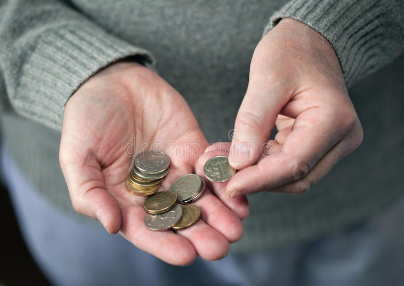 An elderly man counting the coins royalty free stock photos