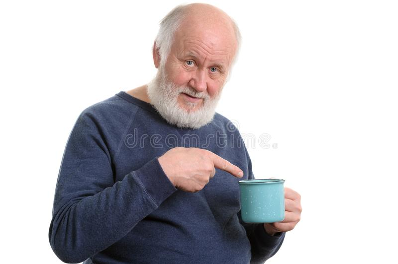 Elderly man with cup of bad tea or coffee isolated on white. Neutral elderly white haired man with blue cup of tea or coffe isolated on white royalty free stock photography