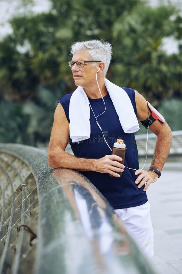 Aged jogger stock image