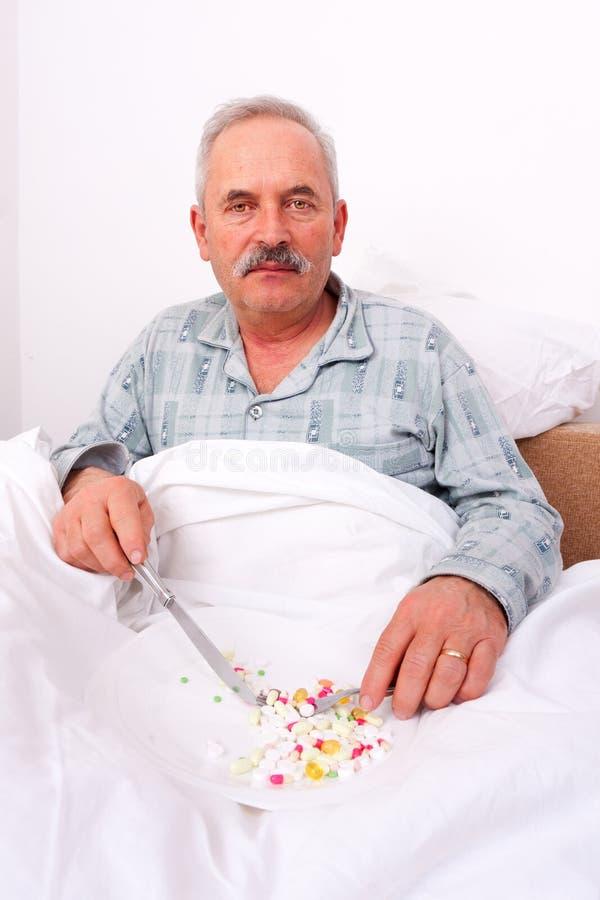 Download Elderly man eating meds stock photo. Image of drug, caucasian - 23732666