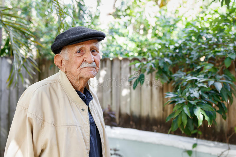 Elderly man. Elderly eighty plus year old man in a outdoor setting royalty free stock image