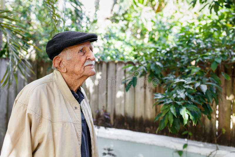 Elderly man. Elderly eighty plus year old man in a outdoor setting royalty free stock photo