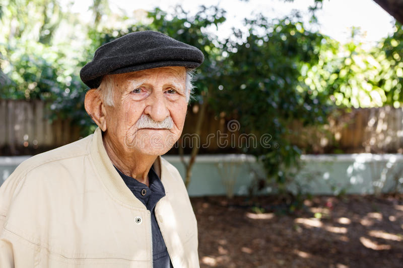 Elderly man. Elderly eighty plus year old man in a outdoor setting royalty free stock photography