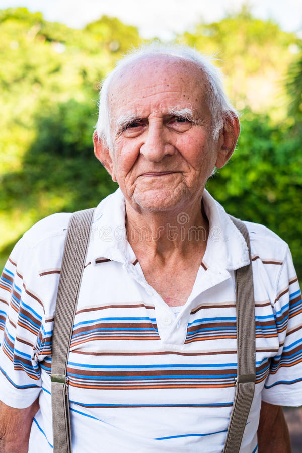 Elderly man. Elderly eighty plus year old man outdoors in a home setting stock photography