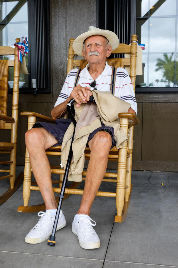 Elderly man. Elderly eighty plus year old man sitting on a rocking chair royalty free stock photography